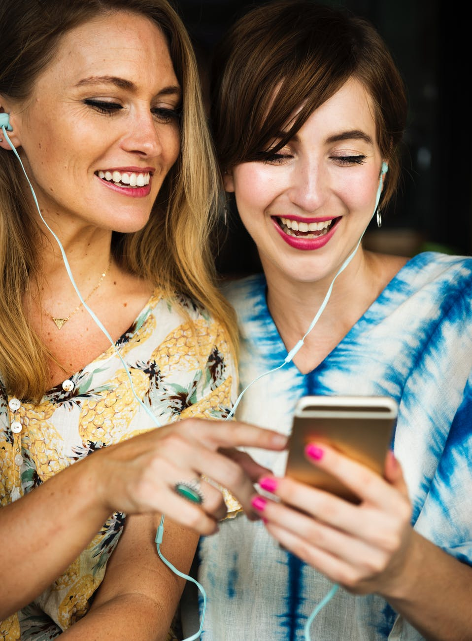 two girls using iphone